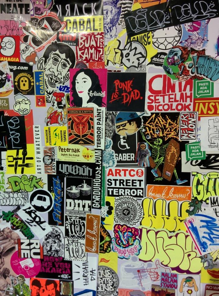 Gw dan Si Punk Rock kemudian berinisiatif menempelkan stiker kami di salah satu dinding Glued ini. Gw sih selalu pengen stiker gw berada di samping stiker Si Punk Rock. Walau stiker kami dikelilingin oleh stiker 'Cinta Setelah Dicolok' dan 'Virgin Is A Myth'. Vaq dem ol! I want to be beside you. Titik!